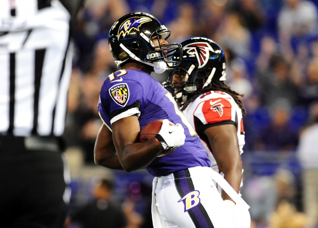 Aug 15, 2013; Baltimore, MD, USA; Baltimore Ravens wide receiver Aaron Mellette (13) celebrates after scoring a 40 yard touchdown in the fourth quarter against the Atlanta Falcons at M&T Bank Stadium. Mandatory Credit: Evan Habeeb-USA TODAY Sports
