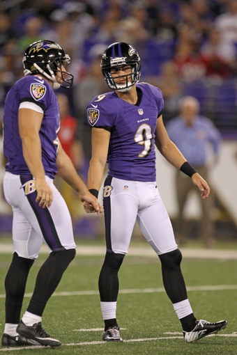 Aug 15, 2013; Baltimore, MD, USA; Baltimore Ravens kicker Justin Tucker (9) is congratulated by holder Sam Koch (4) following his successful extra point attempt against the Atlanta Falcons at M&T Bank Stadium. Mandatory Credit: Mitch Stringer-USA TODAY Sports