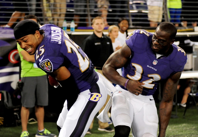 Aug 15, 2013; Baltimore, MD, USA; Baltimore Ravens cornerback Asa Jackson (25) and safety James Ihedigbo (32) celebrate after Jackson scored a touchdown on a 78 yard punt return in the fourth quarter against the Atlanta Falcons at M&T Bank Stadium. Mandatory Credit: Evan Habeeb-USA TODAY Sports