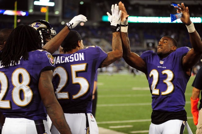 Aug 15, 2013; Baltimore, MD, USA; Baltimore Ravens cornerback Asa Jackson (25) high fives cornerback Chykie Brown (23) after scoring on a 78 yard punt return in the fourth quarter against the Atlanta Falcons at M&T Bank Stadium. Mandatory Credit: Evan Habeeb-USA TODAY Sports