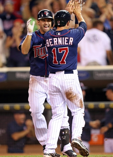 Aug 15, 2013; Minneapolis, MN, USA; Minnesota Twins pinch runner Doug Bernier (17) celebrates with second baseman Brian Dozier (2) after scoring the game winning run in the ninth inning against the Chicago White Sox at Target Field. The Twins won 4-3. Mandatory Credit: Jesse Johnson-USA TODAY Sports