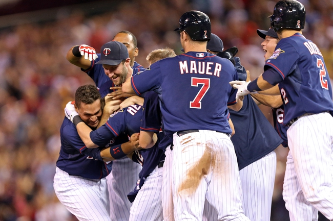 Aug 15, 2013; Minneapolis, MN, USA; Minnesota Twins catcher Chris Herrmann (12) is congratulated by the entire Minnesota Twins team after hitting a game winning single in the ninth inning against the Chicago White Sox at Target Field. The Twins won 4-3. Mandatory Credit: Jesse Johnson-USA TODAY Sports