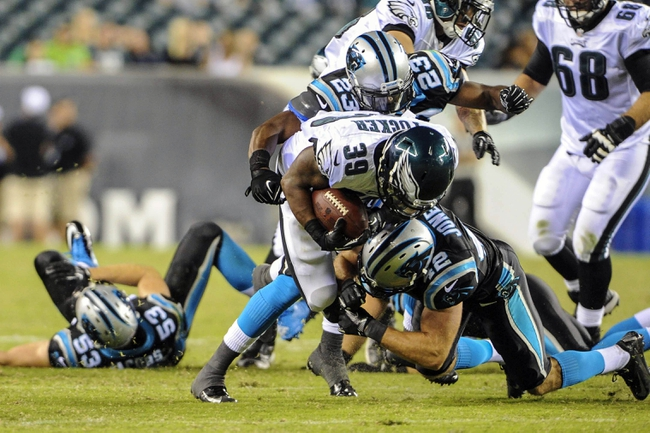 Aug 15, 2013; Philadelphia, PA, USA; Philadelphia Eagles running back Matthew Tucker (39) is tackled by Carolina Panthers defensive back Colin Jones (42) at Lincoln Financial Field.The Philadelphia Eagles beat the Carolina Panthers 14-9. Mandatory Credit: John Geliebter-USA TODAY Sports