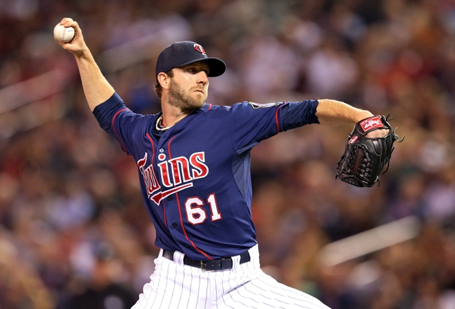 Aug 15, 2013; Minneapolis, MN, USA; Minnesota Twins relief pitcher Jared Burton (61) delivers a pitch in the ninth inning against the Chicago White Sox at Target Field. The Twins won 4-3. Mandatory Credit: Jesse Johnson-USA TODAY Sports