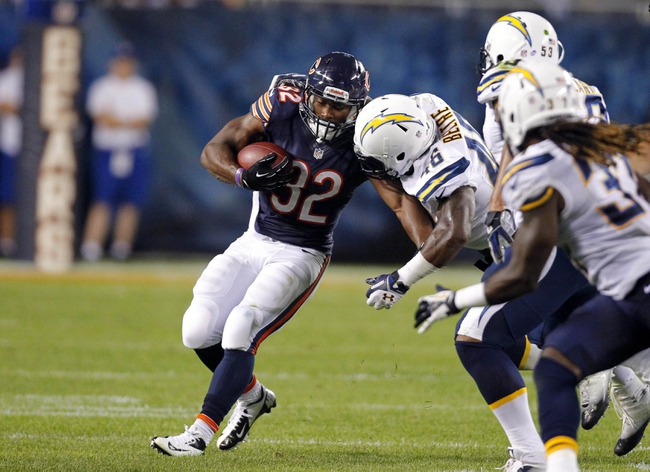 Aug 15, 2013; Chicago, IL, USA;  Chicago Bears running back Michael Ford (32) is tackled by San Diego Chargers linebacker Frank Beltre (46) during the second half at Soldier Field. Chicago won 33-28. Mandatory Credit: Dennis Wierzbicki-USA TODAY Sports