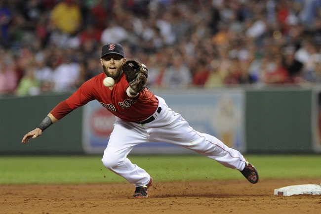 Aug 16, 2013; Boston, MA, USA; Boston Red Sox second baseman Dustin Pedroia (15) reaches for a ball thrown by shortstop Stephen Drew  (not pictured) during the third inning against the New York Yankees at Fenway Park. Mandatory Credit: Bob DeChiara-USA TODAY Sports