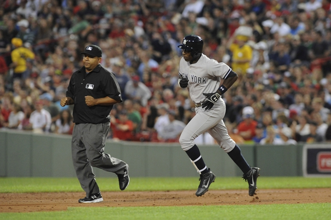 Aug 16, 2013; Boston, MA, USA; New York Yankees left fielder Alfonso Soriano (12) rounds the bases after hitting a three run home run during the third inning against the Boston Red Sox at Fenway Park. Mandatory Credit: Bob DeChiara-USA TODAY Sports