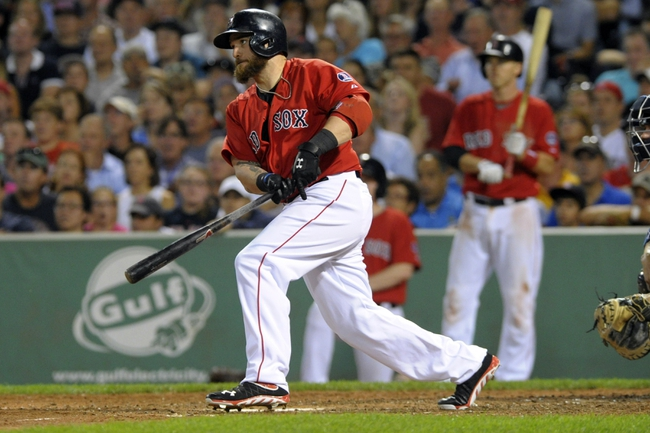 Aug 16, 2013; Boston, MA, USA; Boston Red Sox left fielder Jonny Gomes (5) hits an RBI single during the fourth inning against the New York Yankees at Fenway Park. Mandatory Credit: Bob DeChiara-USA TODAY Sports