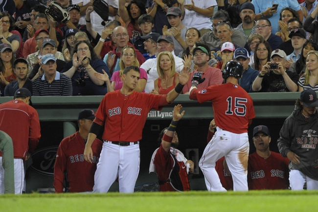Aug 16, 2013; Boston, MA, USA; Boston Red Sox third baseman Will Middlebrooks (16) congratulates second baseman Dustin Pedroia (15) after scoring a run during the fourth inning against the New York Yankees at Fenway Park. Mandatory Credit: Bob DeChiara-USA TODAY Sports