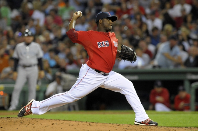 Aug 16, 2013; Boston, MA, USA; Boston Red Sox relief pitcher Rubby De La Rosa (62) pitches during the fifth inning against the New York Yankees at Fenway Park. Mandatory Credit: Bob DeChiara-USA TODAY Sports