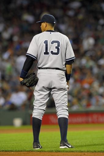 Aug 16, 2013; Boston, MA, USA; New York Yankees third baseman Alex Rodriguez (13) during the sixth inning against the Boston Red Sox at Fenway Park. Mandatory Credit: Bob DeChiara-USA TODAY Sports