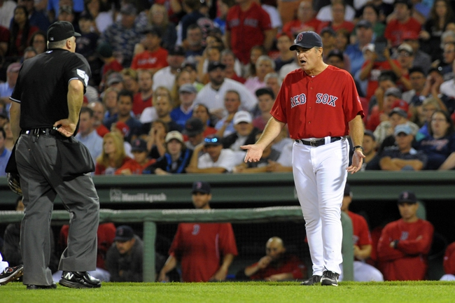 Aug 16, 2013; Boston, MA, USA; Boston Red Sox manager John Farrell (53) argues a call with home plate umpire Bill Welke during the seventh inning against the New York Yankees at Fenway Park. Mandatory Credit: Bob DeChiara-USA TODAY Sports