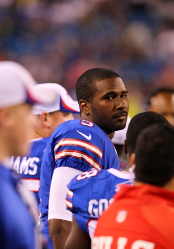 Aug 16, 2013; Orchard Park, NY, USA;  Buffalo Bills quarterback EJ Manuel (3) during the second half on the sidelines against the Minnesota Vikings at Ralph Wilson Stadium.  Buffalo defeats Minnesota 20 to 16.  Mandatory Credit: Timothy T. Ludwig-USA TODAY Sports