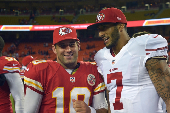 Aug 16, 2013; Kansas City, MO, USA; Kansas City Chiefs quarterback Chase Daniel (10) talks with San Francisco 49ers quarterback Colin Kaepernick (7) after the game at Arrowhead Stadium. San Francisco won 15-13. Mandatory Credit: Denny Medley-USA TODAY Sports