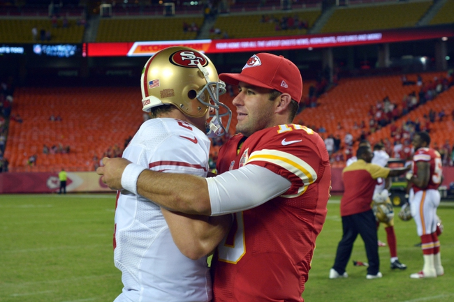 Aug 16, 2013; Kansas City, MO, USA; Kansas City Chiefs quarterback Chase Daniel (10) embraces San Francisco 49ers quarterback Colt McCoy (2) after the game at Arrowhead Stadium. San Francisco won 15-13. Mandatory Credit: Denny Medley-USA TODAY Sports