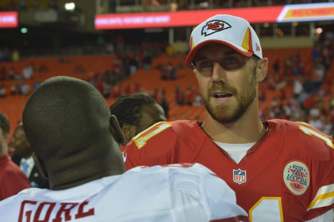 Aug 16, 2013; Kansas City, MO, USA; Kansas City Chiefs quarterback Alex Smith (11) talks with San Francisco 49ers running back Frank Gore (21) after the game at Arrowhead Stadium. San Francisco won 15-13. Mandatory Credit: Denny Medley-USA TODAY Sports