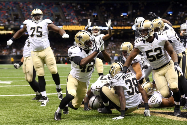 Aug 16, 2013; New Orleans, LA, USA; New Orleans Saints free safety Isa Abdul-Quddus (42) and teammates celebrate a safety in the second half against the Oakland Raiders at the Mercedes-Benz Superdome. New Orleans defeated Oakland 28-20. Mandatory Credit: Crystal LoGiudice-USA TODAY Sports