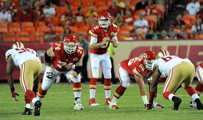 Aug 16, 2013; Kansas City, MO, USA; Kansas City Chiefs quarterback Tyler Bray (9) before the snap during the second half of the game against the San Francisco 49ers at Arrowhead Stadium. San Francisco won 15-13. Mandatory Credit: Denny Medley-USA TODAY Sports