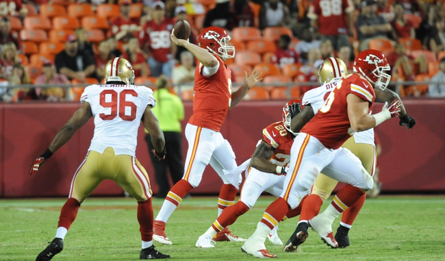 Aug 16, 2013; Kansas City, MO, USA; Kansas City Chiefs quarterback Tyler Bray (9) throws a pass during the second half of the game against the San Francisco 49ers at Arrowhead Stadium. San Francisco won 15-13. Mandatory Credit: Denny Medley-USA TODAY Sports