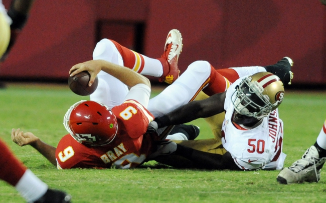 Aug 16, 2013; Kansas City, MO, USA; Kansas City Chiefs quarterback Tyler Bray (9) is sacked by San Francisco 49ers linebacker Cam Johnson (50) during the second half at Arrowhead Stadium. San Francisco won 15-13. Mandatory Credit: Denny Medley-USA TODAY Sports