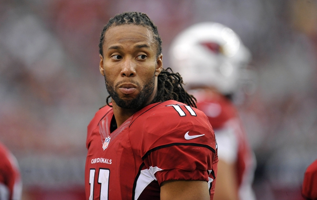 August 17, 2013; Phoenix, AZ, USA; Arizona Cardinals wide receiver Larry Fitzgerald (11) watches game action against Dallas Cowboys during the second half at University of Phoenix Stadium. Mandatory Credit: Gary A. Vasquez-USA TODAY Sports