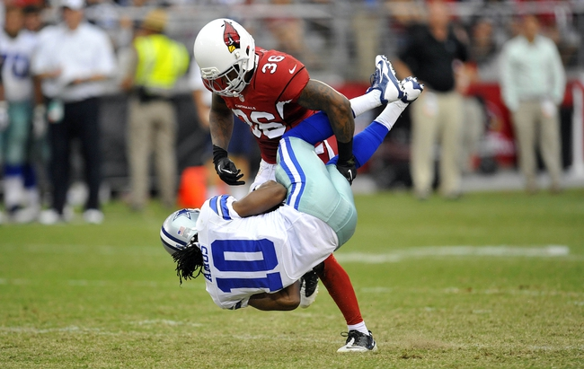 August 17, 2013; Phoenix, AZ, USA; Dallas Cowboys wide receiver Anthony Amos (10) is brought down by Arizona Cardinals defensive back Tony Jefferson (36) during the second half at University of Phoenix Stadium. Mandatory Credit: Gary A. Vasquez-USA TODAY Sports