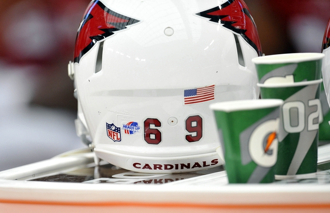 August 17, 2013; Phoenix, AZ, USA; General view of Heads Up decal on Arizona Cardinals helmet at University of Phoenix Stadium. Mandatory Credit: Gary A. Vasquez-USA TODAY Sports