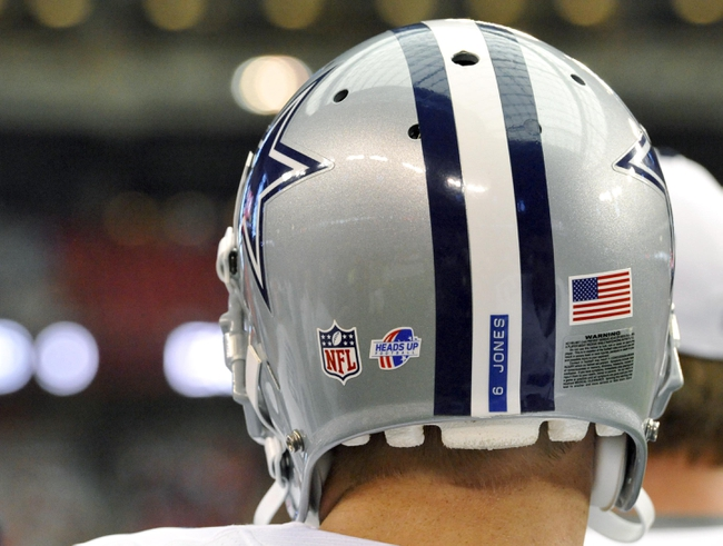 Aug 17, 2013; Phoenix, AZ, USA; General view of a Dallas Cowboys helmet with the heads up decal during the fourth quarter against the Arizona Cardinals at University of Phoenix Stadium. The Cardinals defeated the Cowboys 12-7. Mandatory Credit: Casey Sapio-USA TODAY Sports