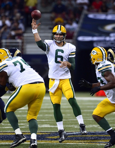 Aug 17, 2013; St. Louis, MO, USA; Green Bay Packers quarterback Graham Harrell (6) attempts a pass against the St. Louis Rams during the first half at the Edward Jones Dome. Mandatory Credit: Scott Rovak-USA TODAY Sports