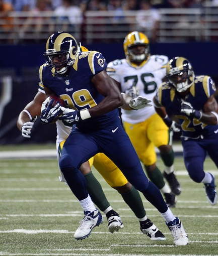 Aug 17, 2013; St. Louis, MO, USA; St. Louis Rams tight end Jared Cook (89) gains 37 yards on a pass completion against the Green Bay Packers during the first half during the first half at the Edward Jones Dome. Mandatory Credit: Scott Rovak-USA TODAY Sports