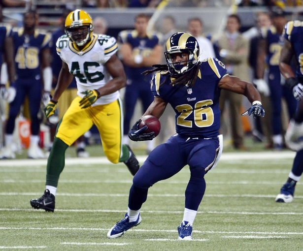 Aug 17, 2013; St. Louis, MO, USA; St. Louis Rams running back Daryl Richardson (26) gains 14 yards against the Green Bay Packers during the first half during the first half at the Edward Jones Dome. Mandatory Credit: Scott Rovak-USA TODAY Sports