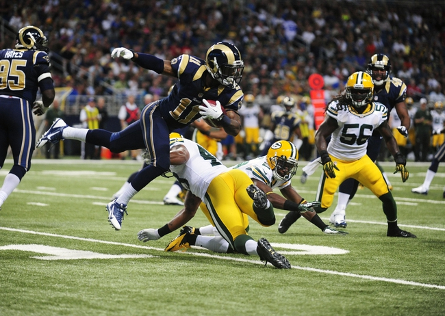 Aug 17, 2013; St. Louis, MO, USA; St. Louis Rams wide receiver Tavon Austin (11) leaps past Green Bay Packers linebacker Rob Francois (49) as he returns a kick off during the first half at the Edward Jones Dome. Mandatory Credit: Jeff Curry-USA TODAY Sports
