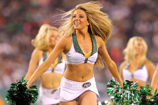 Aug 17, 2013; East Rutherford, NJ, USA; New York Jets cheerleader performs between the third and fourth quarters of a preseason game at MetLife Stadium. The Jets defeated the Jaguars 37-13. Mandatory Credit: Brad Penner-USA TODAY Sports