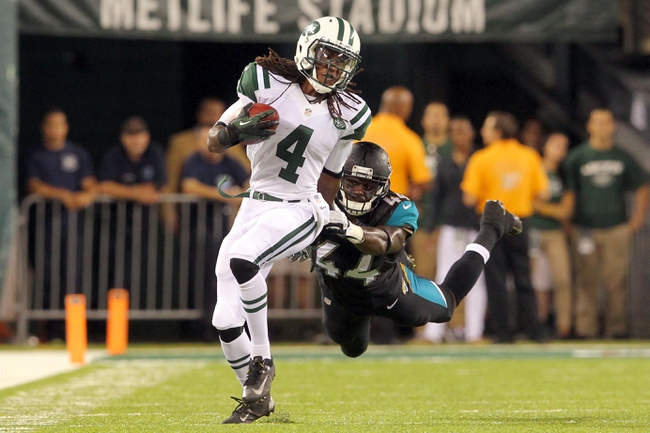 Aug 17, 2013; East Rutherford, NJ, USA; New York Jets wide receiver Joseph Collins (4) breaks away from coverage by Jacksonville Jaguars linebacker Maalik Bomar (44) during the fourth quarter of a preseason game at MetLife Stadium. The Jets defeated the Jaguars 37-13. Mandatory Credit: Brad Penner-USA TODAY Sports