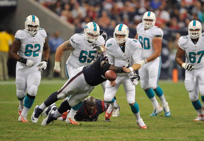 Aug 17, 2013; Houston, TX, USA; Houston Texans nose tackle Terrell McClain (97) sacks Miami Dolphins quarterback Aaron Corp (4) and forces a fumble during the second half at Reliant Stadium. The Texans defeated the Dolphins 24-17. Mandatory Credit: Jerome Miron-USA TODAY Sports