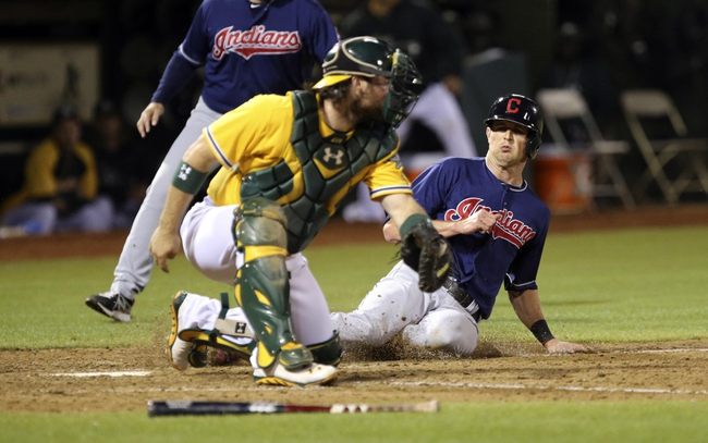 Aug 17, 2013; Oakland, CA, USA; Cleveland Indians right fielder Drew Stubbs (11) slides safely home against Oakland Athletics catcher Derek Norris (36) during the ninth inning at O.co Coliseum. The Cleveland Indians defeated the Oakland Athletics 7-1. Mandatory Credit: Kelley L Cox-USA TODAY Sports
