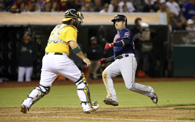 Aug 17, 2013; Oakland, CA, USA; Cleveland Indians first baseman Nick Swisher (33) slides safely past Oakland Athletics catcher Derek Norris (36) during the ninth inning at O.co Coliseum. The Cleveland Indians defeated the Oakland Athletics 7-1. Mandatory Credit: Kelley L Cox-USA TODAY Sports