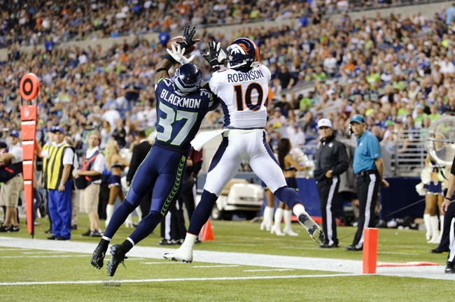 Aug 17, 2013; Seattle, WA, USA; Seattle Seahawks defensive back Will Blackmon (37) breaks up a pass in the end zone intended for Denver Broncos wide receiver Gerell Robinson (10) during the 2nd half at CenturyLink Field. Seattle defeated Denver 40-10. Mandatory Credit: Steven Bisig-USA TODAY Sports