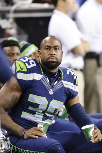 Aug 17, 2013; Seattle, WA, USA; Seattle Seahawks cornerback Brandon Browner (39) on the sidelines during the 2nd half against the Denver Broncos at CenturyLink Field. Seattle defeated Denver 40-10. Mandatory Credit: Steven Bisig-USA TODAY Sports