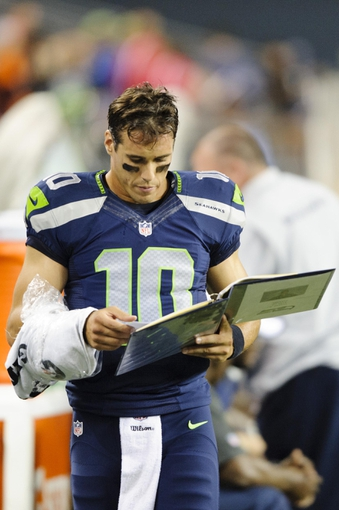 Aug 17, 2013; Seattle, WA, USA; Seattle Seahawks quarterback Brady Quinn (10) on the sideline during the 2nd half against the Denver Broncos at CenturyLink Field. Seattle defeated Denver 40-10. Mandatory Credit: Steven Bisig-USA TODAY Sports