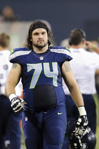 Aug 17, 2013; Seattle, WA, USA; Seattle Seahawks guard John Moffitt (74) on the sidelines during the 2nd half against the Denver Broncos at CenturyLink Field. Seattle defeated Denver 40-10. Mandatory Credit: Steven Bisig-USA TODAY Sports