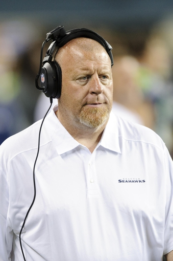 Aug 17, 2013; Seattle, WA, USA; Seattle Seahawks assistant head coach Tom Cable on the sidelines during the 2nd half against the Denver Broncos at CenturyLink Field. Seattle defeated Denver 40-10. Mandatory Credit: Steven Bisig-USA TODAY Sports