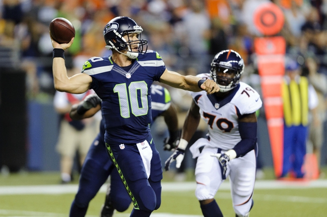 Aug 17, 2013; Seattle, WA, USA; Seattle Seahawks quarterback Brady Quinn (10) passes the ball during the 2nd half against the Denver Broncos at CenturyLink Field. Seattle defeated Denver 40-10. Mandatory Credit: Steven Bisig-USA TODAY Sports