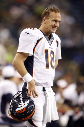 Aug 17, 2013; Seattle, WA, USA; Denver Broncos quarterback Peyton Manning (18) stands on the sidelines during the second half against the Seattle Seahawks at CenturyLink Field. Mandatory Credit: Joe Nicholson-USA TODAY Sports