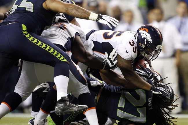 Aug 17, 2013; Seattle, WA, USA; Denver Broncos running back Lance Ball (35) rushes against the Seattle Seahawks during the fourth quarter at CenturyLink Field. Mandatory Credit: Joe Nicholson-USA TODAY Sports
