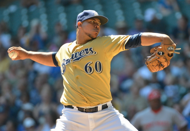 Aug 18, 2013; Milwaukee, WI, USA;  Milwaukee Brewers pitcher Wily Peralta pitches in the first inning against the Cincinnati Reds at Miller Park. Mandatory Credit: Benny Sieu-USA TODAY Sports