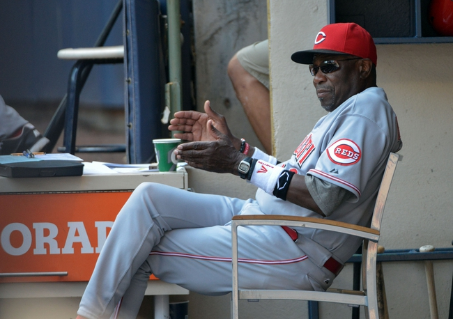 Aug 18, 2013; Milwaukee, WI, USA;  Cincinnati Reds manager Dusty Baker watches the game in the fifth inning against the Milwaukee Brewers at Miller Park. Mandatory Credit: Benny Sieu-USA TODAY Sports