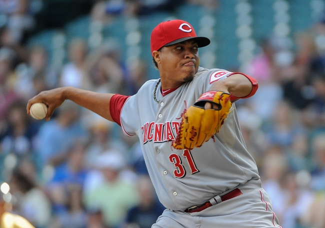 Aug 18, 2013; Milwaukee, WI, USA;  Cincinnati Reds pitcher Alfredo Simon pitches in the ninth inning against the Milwaukee Brewers at Miller Park. Mandatory Credit: Benny Sieu-USA TODAY Sports