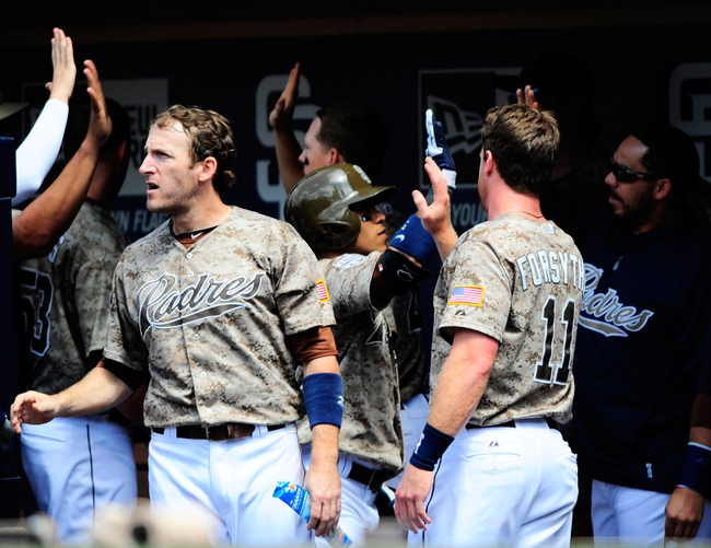 Aug 18, 2013; San Diego, CA, USA; San Diego Padres players celebrate after scoring during the fifth inning against the New York Mets at Petco Park. Mandatory Credit: Christopher Hanewinckel-USA TODAY Sports