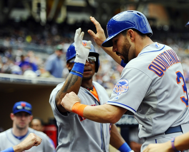 Aug 18, 2013; San Diego, CA, USA; New York Mets shortstop Omar Quintanilla (3) is congratulated by right fielder Marlon Byrd (6) after scoring during the seventh inning against the San Diego Padres at Petco Park. Mandatory Credit: Christopher Hanewinckel-USA TODAY Sports